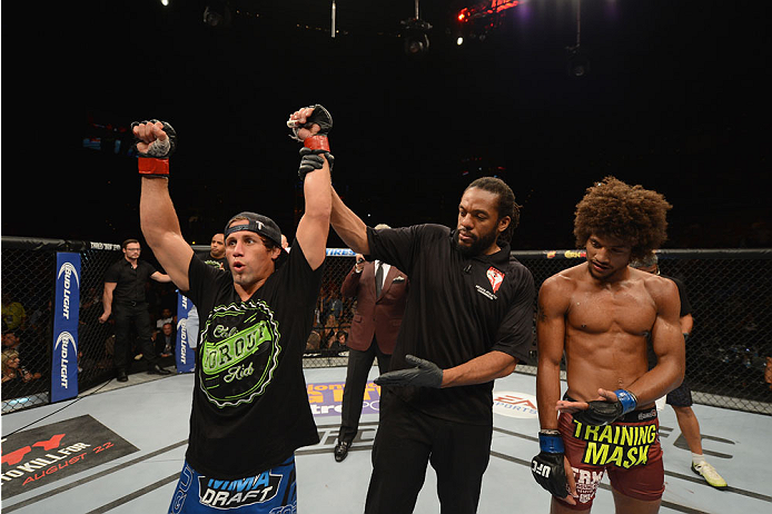 LAS VEGAS, NV - JULY 05:  (L-R) Uriah Faber celebrates his submission win over Alex Caceres in their bantamweight fight at UFC 175 inside the Mandalay Bay Events Center on July 5, 2014 in Las Vegas, Nevada.  (Photo by Donald Miralle/Zuffa LLC/Zuffa LLC via Getty Images)
