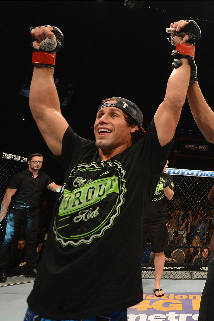 LAS VEGAS, NV - JULY 05: Uriah Faber celebrates his submission win over Alex Caceres in their bantamweight fight at UFC 175 inside the Mandalay Bay Events Center on July 5, 2014 in Las Vegas, Nevada. (Photo by Donald Miralle/Zuffa LLC/Zuffa LLC via Getty Images)