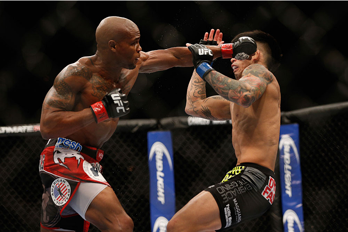 LAS VEGAS, NV - JULY 05: (L-R) Marcus Brimage punches Russel Doane in their bantamweight fight at UFC 175 inside the Mandalay Bay Events Center on July 5, 2014 in Las Vegas, Nevada.  (Photo by Josh Hedges/Zuffa LLC/Zuffa LLC via Getty Images)