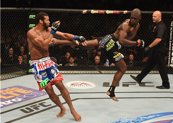 LAS VEGAS, NV - JULY 05:  (R-L) Uriah Hall kicks Thiago Santos during their middleweight fight at UFC 175 inside the Mandalay Bay Events Center on July 5, 2014 in Las Vegas, Nevada.  (Photo by Donald Miralle/Zuffa LLC/Zuffa LLC via Getty Images)