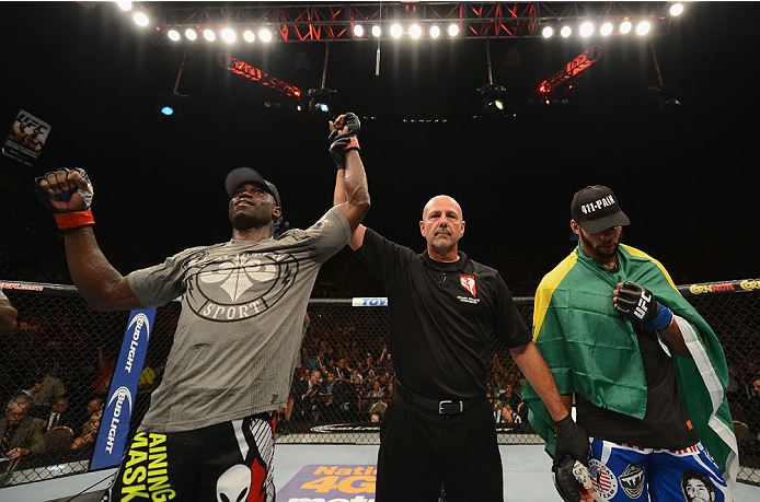 LAS VEGAS, NV - JULY 05:  (L-R) Uriah Hall celebrates his win over Thiago Santos during their middleweight fight at UFC 175 inside the Mandalay Bay Events Center on July 5, 2014 in Las Vegas, Nevada.  (Photo by Donald Miralle/Zuffa LLC/Zuffa LLC via Getty Images)