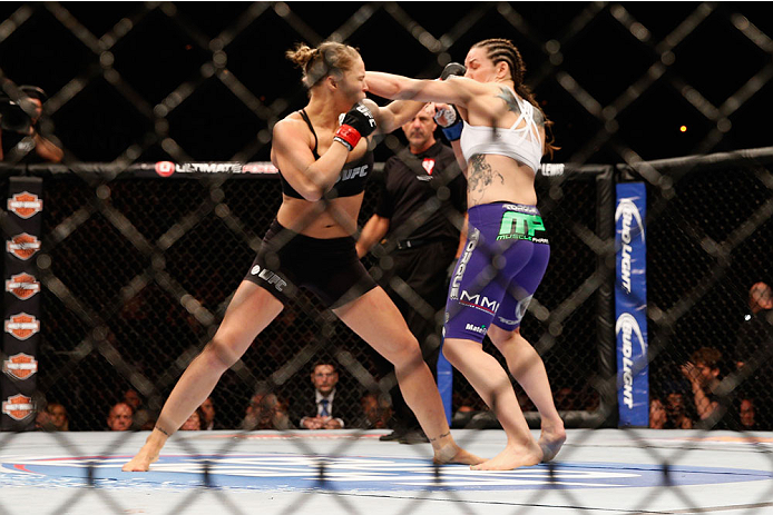 LAS VEGAS, NV - JULY 05:  (R-L) UFC bantamweight Champion Ronda Rousey exchanges punches with Alexis Davis in their UFC women's bantamweight championship fight at UFC 175 inside the Mandalay Bay Events Center on July 5, 2014 in Las Vegas, Nevada.  (Photo by Josh Hedges/Zuffa LLC/Zuffa LLC via Getty Images)