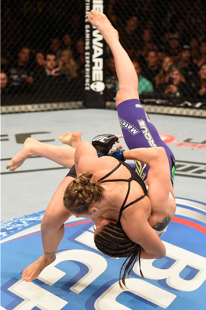 LAS VEGAS, NV - JULY 05:  (L-R) UFC bantamweight Champion Ronda Rousey throws down Alexis Davis in their UFC women's bantamweight championship fight at UFC 175 inside the Mandalay Bay Events Center on July 5, 2014 in Las Vegas, Nevada.  (Photo by Donald Miralle/Zuffa LLC/Zuffa LLC via Getty Images)