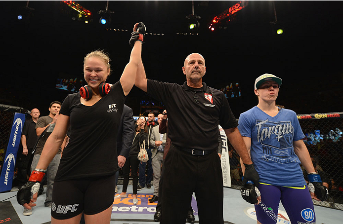 LAS VEGAS, NV - JULY 05:  (L-R) UFC women's bantamweight champion celebrates defeating Alexis Davis after their UFC women's bantamweight championship fight at UFC 175 inside the Mandalay Bay Events Center on July 5, 2014 in Las Vegas, Nevada.  (Photo by Donald Miralle/Zuffa LLC/Zuffa LLC via Getty Images)