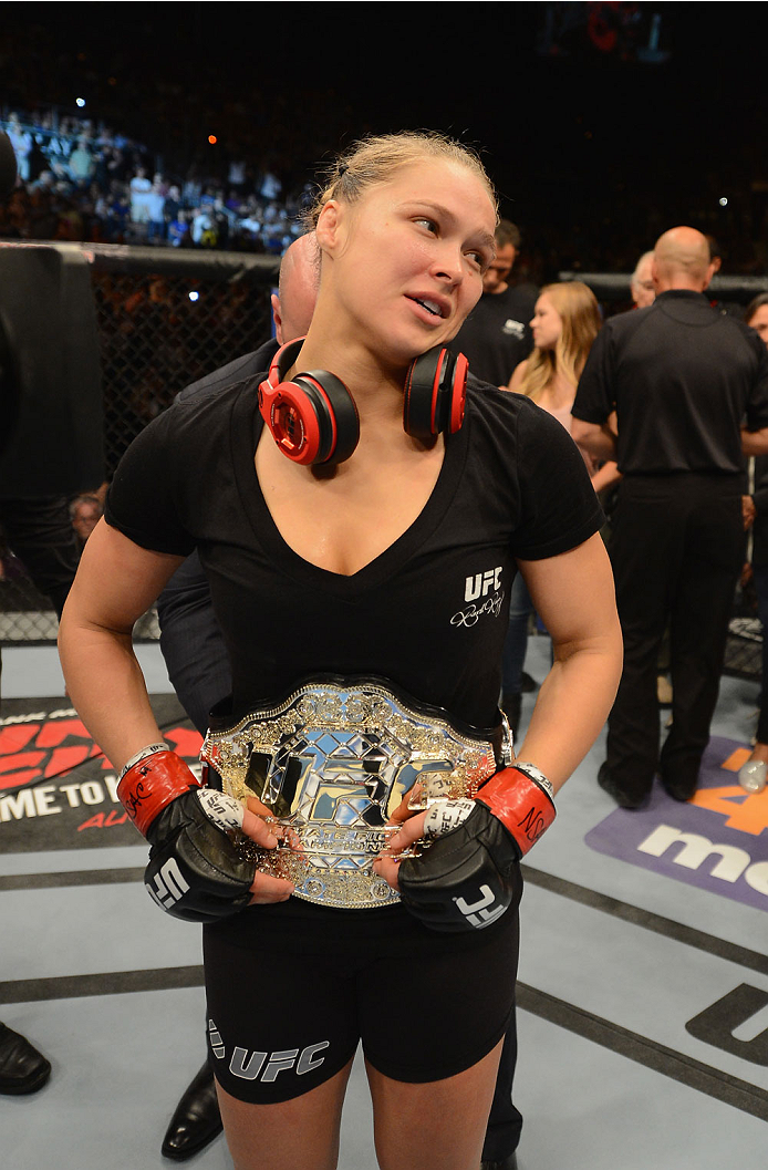 LAS VEGAS, NV - JULY 05:  (L-R) UFC women's bantamweight champion Ronda Rousey celebrates defeating Alexis Davis after their UFC women's bantamweight championship fight at UFC 175 inside the Mandalay Bay Events Center on July 5, 2014 in Las Vegas, Nevada.  (Photo by Donald Miralle/Zuffa LLC/Zuffa LLC via Getty Images)