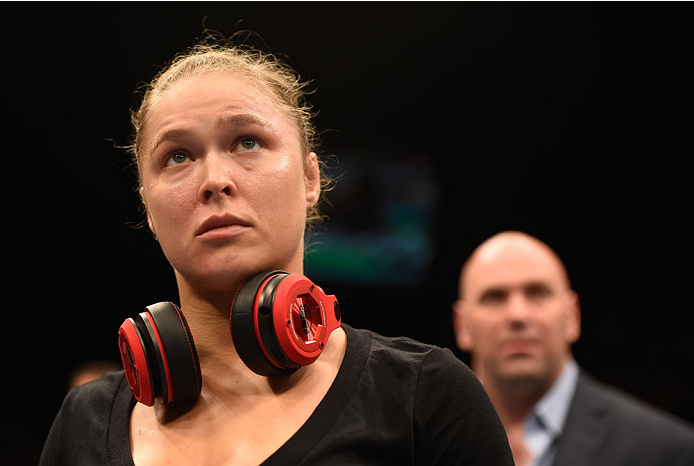 LAS VEGAS, NV - JULY 05:  (L-R) UFC women's bantamweight champion Ronda Rousey reacts to defeating Alexis Davis after their UFC women's bantamweight championship fight at UFC 175 inside the Mandalay Bay Events Center on July 5, 2014 in Las Vegas, Nevada.  (Photo by Donald Miralle/Zuffa LLC/Zuffa LLC via Getty Images)