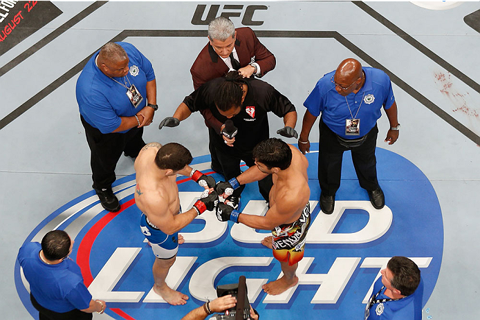 LAS VEGAS, NV - JULY 05:  (L-R) A view from above of UFC middleweight champion Chris Weidman touching gloves with Lyoto Machida before their UFC middleweight championship fight at UFC 175 inside the Mandalay Bay Events Center on July 5, 2014 in Las Vegas, Nevada.  (Photo by Josh Hedges/Zuffa LLC/Zuffa LLC via Getty Images)
