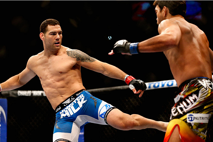 LAS VEGAS, NV - JULY 05:  (L-R) UFC middleweight champion Chris Weidman kicks Lyoto Machida in their UFC middleweight championship fight at UFC 175 inside the Mandalay Bay Events Center on July 5, 2014 in Las Vegas, Nevada.  (Photo by Josh Hedges/Zuffa LLC/Zuffa LLC via Getty Images)