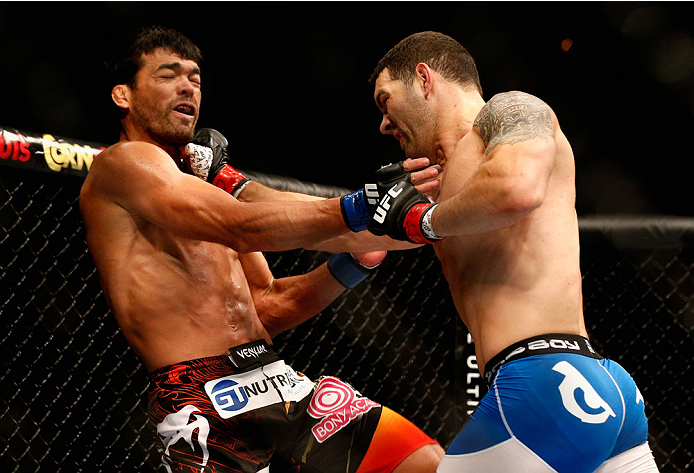 LAS VEGAS, NV - JULY 05:  (R-L) UFC middleweight champion Chris Weidman punches Lyoto Machida in their UFC middleweight championship fight at UFC 175 inside the Mandalay Bay Events Center on July 5, 2014 in Las Vegas, Nevada.  (Photo by Josh Hedges/Zuffa LLC/Zuffa LLC via Getty Images)