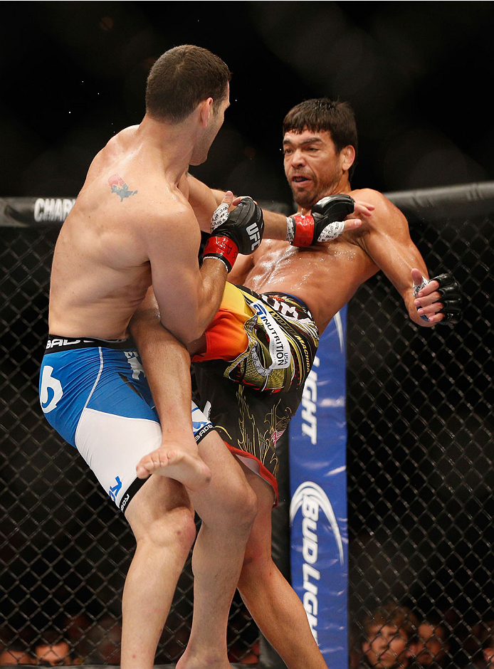 LAS VEGAS, NV - JULY 05:  (R-L) Lyoto Machida knees UFC middleweight champion Chris Weidman in their UFC middleweight championship fight at UFC 175 inside the Mandalay Bay Events Center on July 5, 2014 in Las Vegas, Nevada.  (Photo by Josh Hedges/Zuffa LLC/Zuffa LLC via Getty Images)