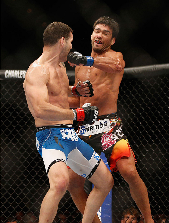 LAS VEGAS, NV - JULY 05:  (R-L) Lyoto Machida punches UFC middleweight champion Chris Weidman in their UFC middleweight championship fight at UFC 175 inside the Mandalay Bay Events Center on July 5, 2014 in Las Vegas, Nevada.  (Photo by Josh Hedges/Zuffa LLC/Zuffa LLC via Getty Images)