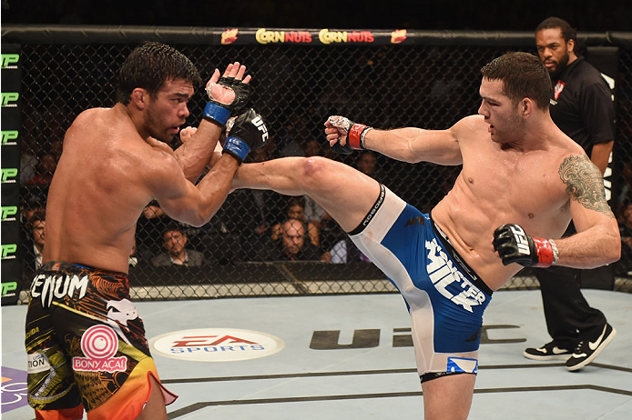LAS VEGAS, NV - JULY 05:  (R-L) UFC middleweight champion Chris Weidman kicks Lyoto Machida in their UFC middleweight championship fight at UFC 175 inside the Mandalay Bay Events Center on July 5, 2014 in Las Vegas, Nevada.  (Photo by Donald Miralle/Zuffa LLC/Zuffa LLC via Getty Images)