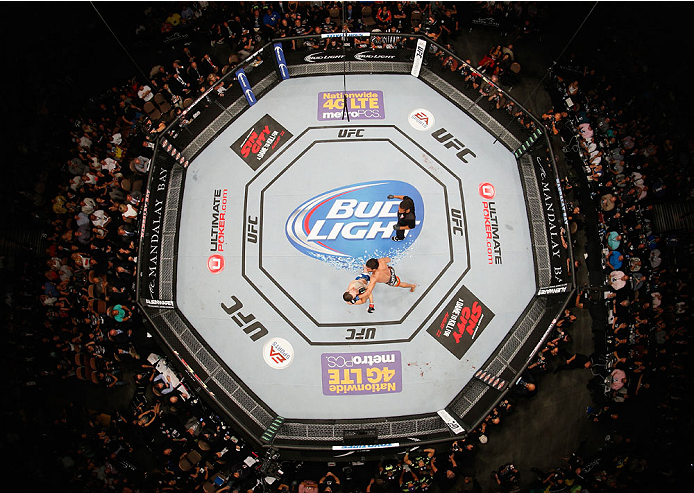 LAS VEGAS, NV - JULY 05:  (L-R) A view from above of Lyoto Machida punching UFC middleweight champion Chris Weidman during their UFC middleweight championship fight at UFC 175 inside the Mandalay Bay Events Center on July 5, 2014 in Las Vegas, Nevada.  (Photo by Josh Hedges/Zuffa LLC/Zuffa LLC via Getty Images)