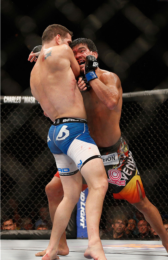 LAS VEGAS, NV - JULY 05:  (R-L) Lyoto Machida charges UFC middleweight champion Chris Weidman in their UFC middleweight championship fight at UFC 175 inside the Mandalay Bay Events Center on July 5, 2014 in Las Vegas, Nevada.  (Photo by Josh Hedges/Zuffa LLC/Zuffa LLC via Getty Images)
