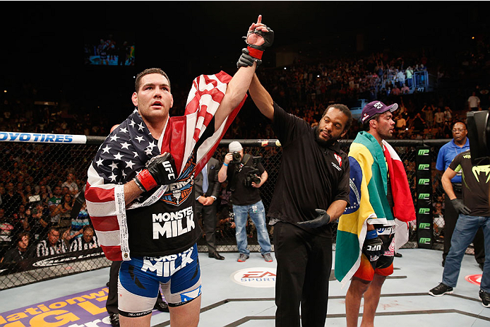LAS VEGAS, NV - JULY 05:  (L-R) UFC middleweight champion Chris Weidman celebrates his win over Lyoto Machida in their UFC middleweight championship fight at UFC 175 inside the Mandalay Bay Events Center on July 5, 2014 in Las Vegas, Nevada.  (Photo by Josh Hedges/Zuffa LLC/Zuffa LLC via Getty Images)