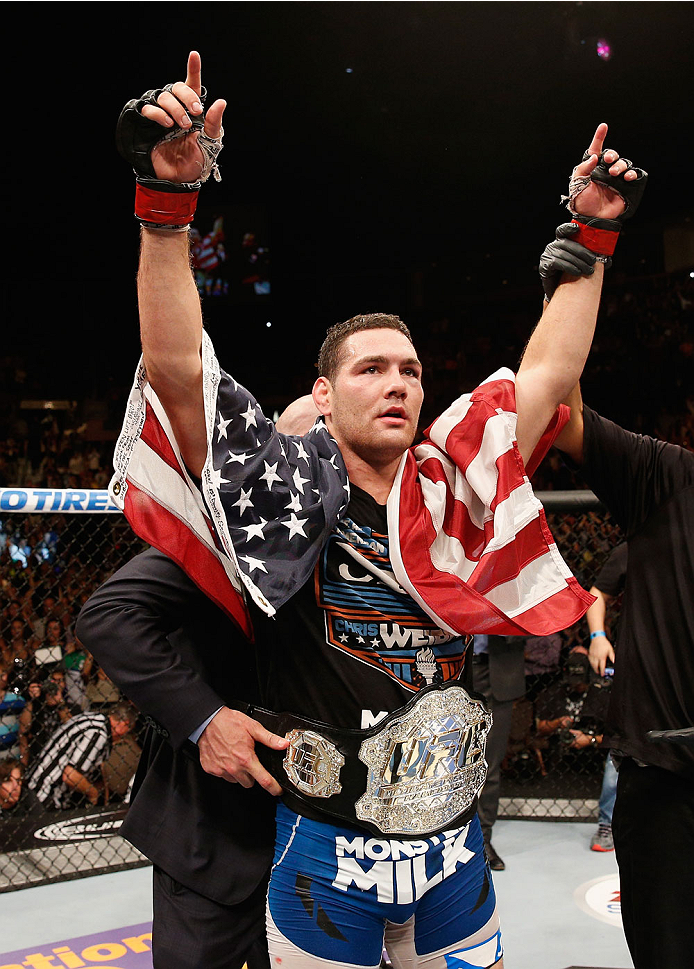 LAS VEGAS, NV - JULY 05:  UFC middleweight champion Chris Weidman celebrates his win over Lyoto Machida in their UFC middleweight championship fight at UFC 175 inside the Mandalay Bay Events Center on July 5, 2014 in Las Vegas, Nevada.  (Photo by Josh Hedges/Zuffa LLC/Zuffa LLC via Getty Images)