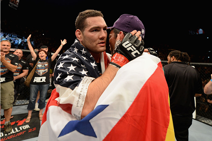 LAS VEGAS, NV - JULY 05:  (L-R) UFC middleweight champion Chris Weidman embraces Lyoto Machida after their UFC middleweight championship fight at UFC 175 inside the Mandalay Bay Events Center on July 5, 2014 in Las Vegas, Nevada.  (Photo by Donald Miralle/Zuffa LLC/Zuffa LLC via Getty Images)