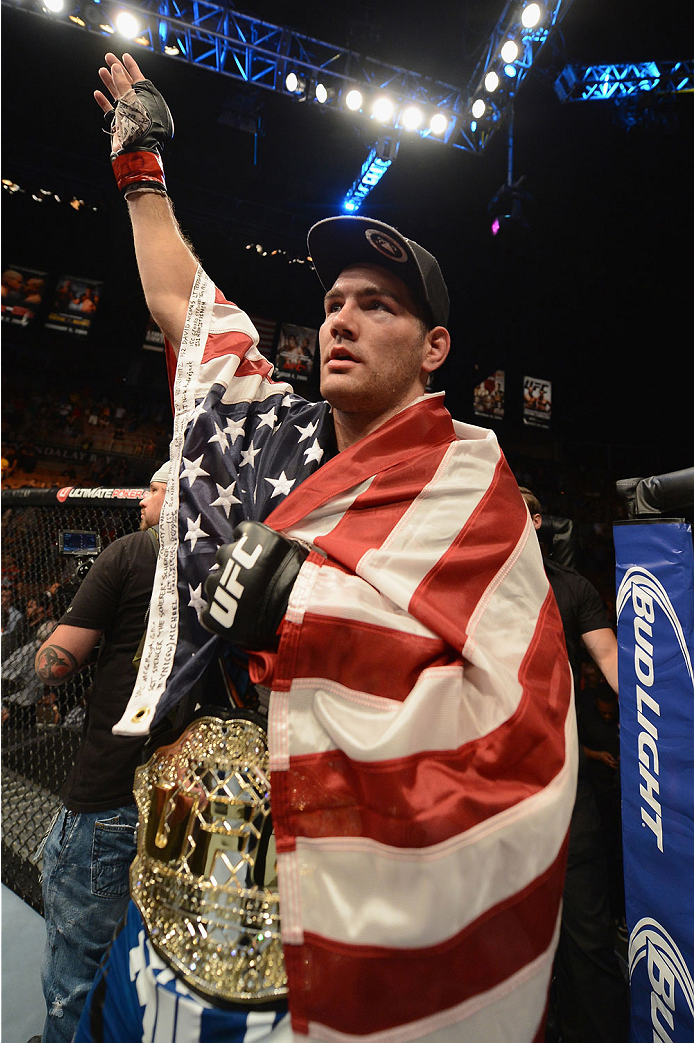 LAS VEGAS, NV - JULY 05:  UFC middleweight champion Chris Weidman celebrates defeating Lyoto Machida in their UFC middleweight championship fight at UFC 175 inside the Mandalay Bay Events Center on July 5, 2014 in Las Vegas, Nevada.  (Photo by Donald Miralle/Zuffa LLC/Zuffa LLC via Getty Images)