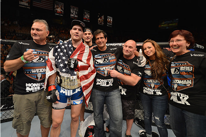 LAS VEGAS, NV - JULY 05:  UFC middleweight champion Chris Weidman celebrates his win over Lyoto Machida in their UFC middleweight championship fight at UFC 175 inside the Mandalay Bay Events Center on July 5, 2014 in Las Vegas, Nevada.  (Photo by Donald Miralle/Zuffa LLC/Zuffa LLC via Getty Images)