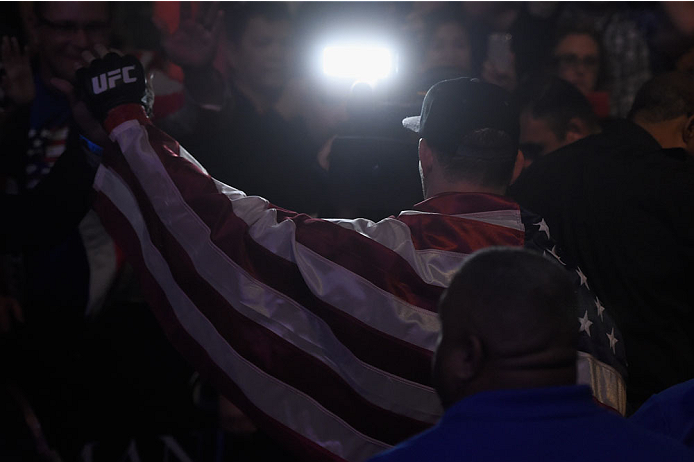 LAS VEGAS, NV - JULY 05:  UFC middleweight champion Chris Weidman exits the Octagon after defeating Lyoto Machida in their UFC middleweight championship fight at UFC 175 inside the Mandalay Bay Events Center on July 5, 2014 in Las Vegas, Nevada.  (Photo by Donald Miralle/Zuffa LLC/Zuffa LLC via Getty Images)