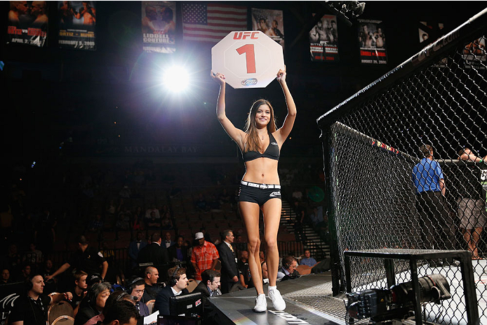 LAS VEGAS, NV - JULY 05:  UFC Octagon Girl Vanessa Hanson announces the first round in their middleweight fight at UFC 175 inside the Mandalay Bay Events Center on July 5, 2014 in Las Vegas, Nevada.  (Photo by Josh Hedges/Zuffa LLC/Zuffa LLC via Getty Images)