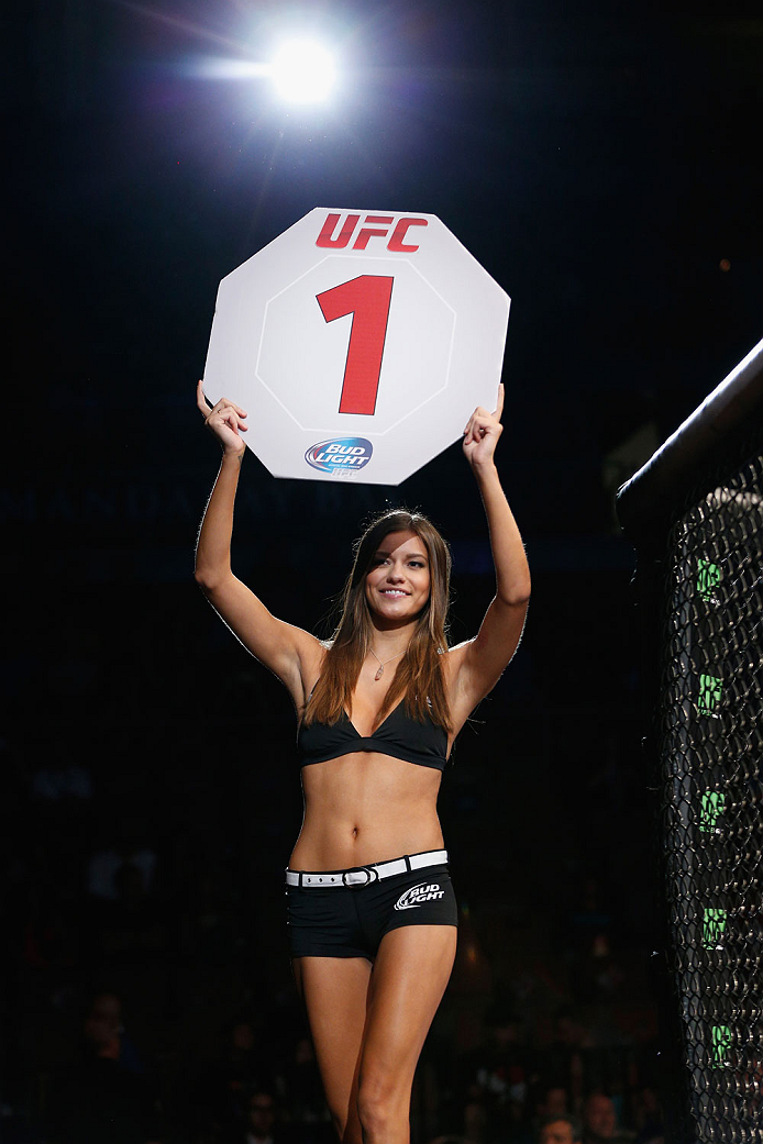 LAS VEGAS, NV - JULY 05:  UFC Octagon Girl Vanessa Hanson announces the first round at UFC 175 inside the Mandalay Bay Events Center on July 5, 2014 in Las Vegas, Nevada.  (Photo by Josh Hedges/Zuffa LLC/Zuffa LLC via Getty Images)