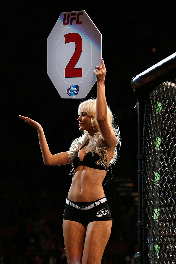 LAS VEGAS, NV - JULY 05:  UFC Octagon Girl Jhenny Andrade announces the second round at UFC 175 inside the Mandalay Bay Events Center on July 5, 2014 in Las Vegas, Nevada.  (Photo by Josh Hedges/Zuffa LLC/Zuffa LLC via Getty Images)
