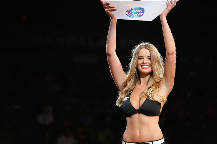 LAS VEGAS, NV - JULY 05:  UFC Octagon Girl Kahili Blundell announces the next round at UFC 175 inside the Mandalay Bay Events Center on July 5, 2014 in Las Vegas, Nevada.  (Photo by Josh Hedges/Zuffa LLC/Zuffa LLC via Getty Images)