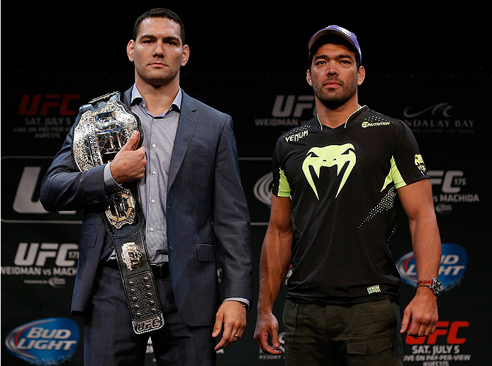 LAS VEGAS, NV - JULY 03:  (L-R) Opponents Chris Weidman and Lyoto Machida pose for photos during the UFC Ultimate Media Day at the Mandalay Bay Resort and Casino on July 3, 2014 in Las Vegas, Nevada.  (Photo by Josh Hedges/Zuffa LLC/Zuffa LLC via Getty Images)