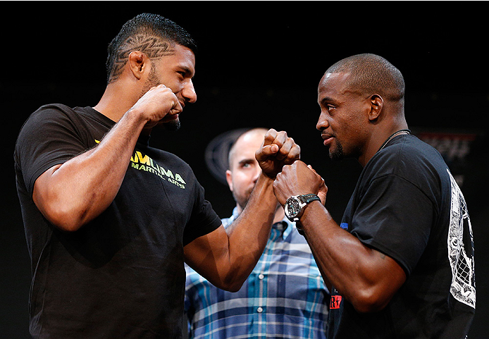 LAS VEGAS, NV - JULY 03:  (L-R) Opponents Dhiego Lima and Eddie Gordon face off during the UFC Ultimate Media Day at the Mandalay Bay Resort and Casino on July 3, 2014 in Las Vegas, Nevada.  (Photo by Josh Hedges/Zuffa LLC/Zuffa LLC via Getty Images)