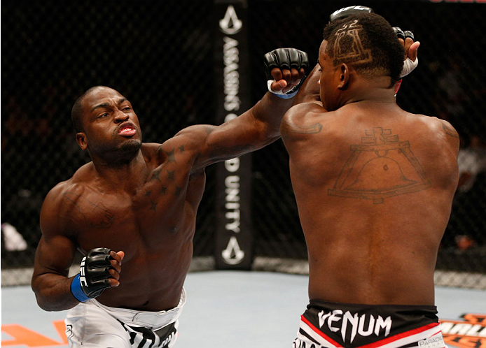 Derek Brunson punches <a href='../fighter/Lorenz-Larkin'>Lorenz Larkin</a> in their middleweight bout during the UFC 177 event at Sleep Train Arena on August 30, 2014 in Sacramento, California. (Photo by Josh Hedges/Zuffa LLC)