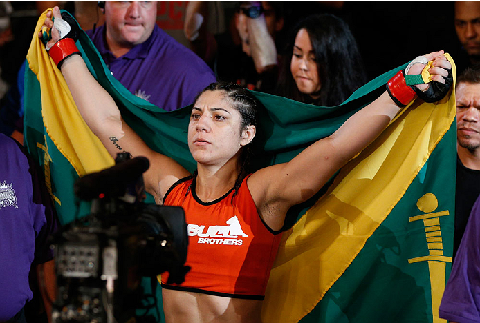 SACRAMENTO, CA - AUGUST 30:  Bethe Correia of Brazil enters the arena before her women's bantamweight bout against Shayna Baszler during the UFC 177 event at Sleep Train Arena on August 30, 2014 in Sacramento, California.  (Photo by Josh Hedges/Zuffa LLC/Zuffa LLC via Getty Images)