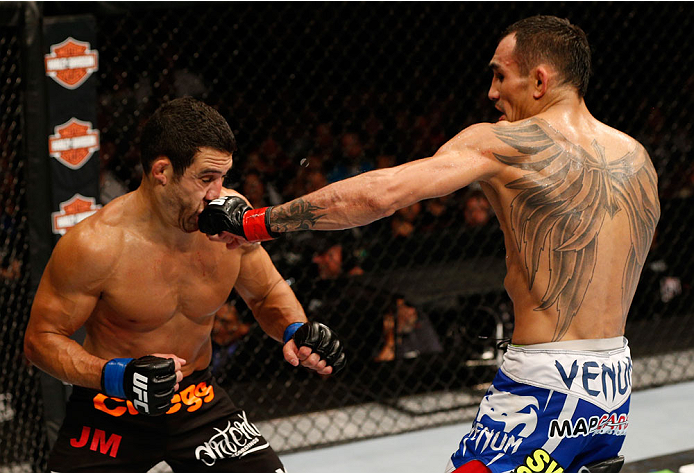 SACRAMENTO, CA - AUGUST 30:  (R-L) Tony Ferguson punhces Danny Castillo in their lightweight bout during the UFC 177 event at Sleep Train Arena on August 30, 2014 in Sacramento, California.  (Photo by Josh Hedges/Zuffa LLC/Zuffa LLC via Getty Images)