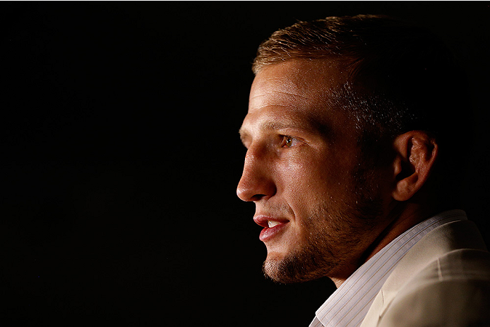 SACRAMENTO, CA - AUGUST 28:  UFC bantamweight champion T.J. Dillashaw interacts with media during the UFC 177 Ultimate Media Day at the Sleep Train Arena on August 28, 2014 in Sacramento, California. (Photo by Josh Hedges/Zuffa LLC/Zuffa LLC via Getty Images)