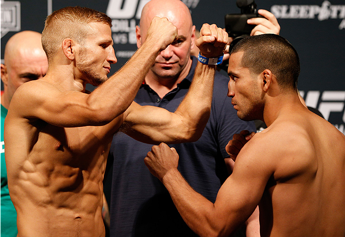 SACRAMENTO, CA - AUGUST 29:  (L-R) Opponents T.J. Dillashaw and Joe Soto face off during the UFC 177 weigh-in at Sleep Train Arena on August 29, 2014 in Sacramento, California.  (Photo by Josh Hedges/Zuffa LLC/Zuffa LLC via Getty Images)