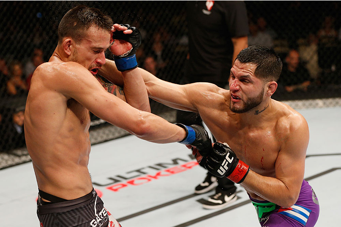 LAS VEGAS, NV - SEPTEMBER 27:  (R-L) Jorge Masvidal punches James Krause in their lightweight fight during the UFC 178 event inside the MGM Grand Garden Arena on September 27, 2014 in Las Vegas, Nevada.  (Photo by Josh Hedges/Zuffa LLC/Zuffa LLC via Getty Images)