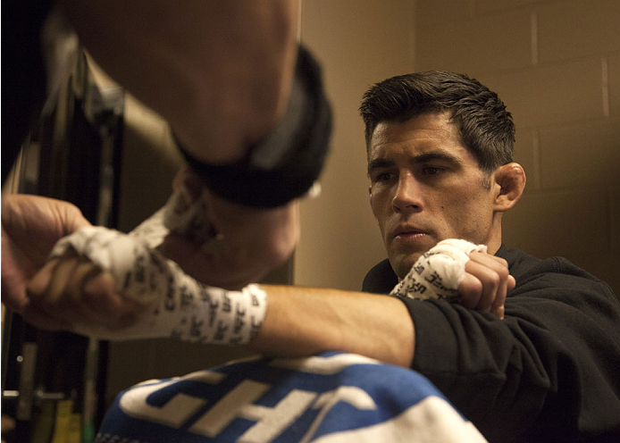 LAS VEGAS, NV - SEPTEMBER 27:  Dominick Cruz gets his hands wrapped before his fight against Takeya Mizugaki during the UFC 178 event inside the MGM Grand Garden Arena on September 27, 2014 in Las Vegas, Nevada. (Photo by Brandon Magnus/Zuffa LLC/Zuffa LLC via Getty Images)