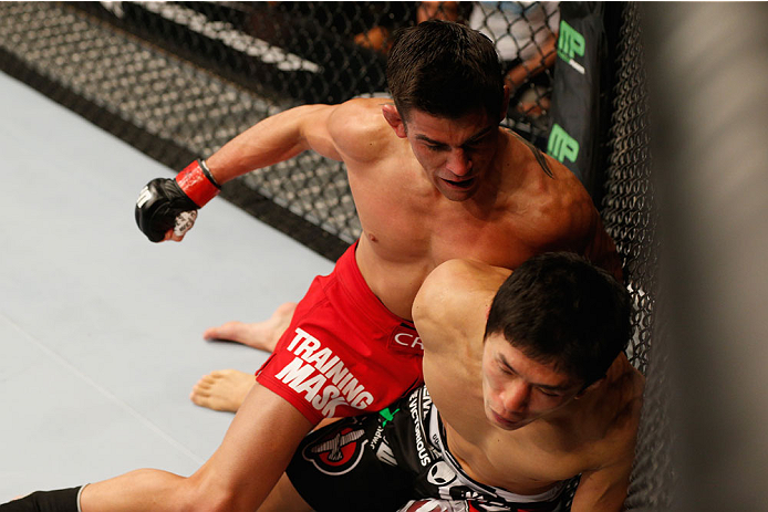 LAS VEGAS, NV - SEPTEMBER 27:  (L-R) Dominick Cruz punches Takeya Mizugaki in their bantamweight fight during the UFC 178 event inside the MGM Grand Garden Arena on September 27, 2014 in Las Vegas, Nevada.  (Photo by Josh Hedges/Zuffa LLC/Zuffa LLC via Getty Images)