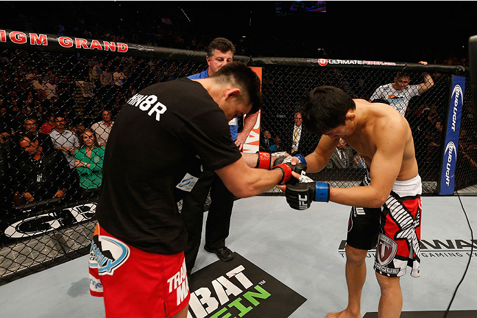 LAS VEGAS, NV - SEPTEMBER 27:  (L-R) Dominick Cruz and Takeya Mizugaki show respect towards each other after their bantamweight fight during the UFC 178 event inside the MGM Grand Garden Arena on September 27, 2014 in Las Vegas, Nevada.  (Photo by Josh Hedges/Zuffa LLC/Zuffa LLC via Getty Images)