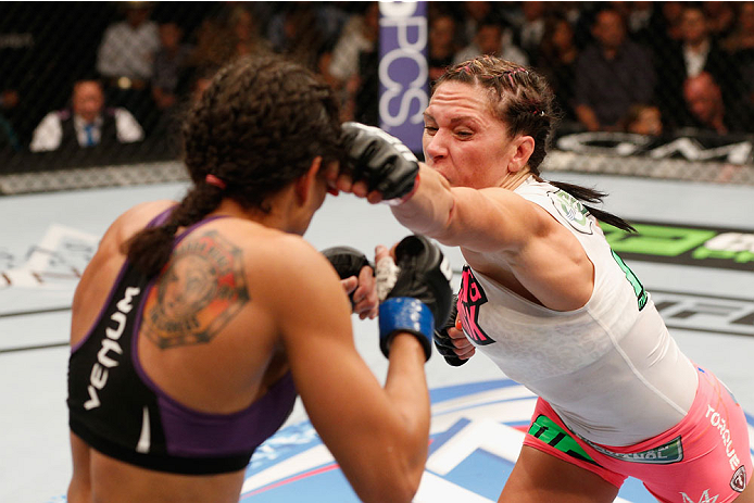 LAS VEGAS, NV - SEPTEMBER 27:  (R-L) Cat Zingano punches Amanda Nunes in their women's bantamweight fight during the UFC 178 event inside the MGM Grand Garden Arena on September 27, 2014 in Las Vegas, Nevada.  (Photo by Josh Hedges/Zuffa LLC/Zuffa LLC via Getty Images)