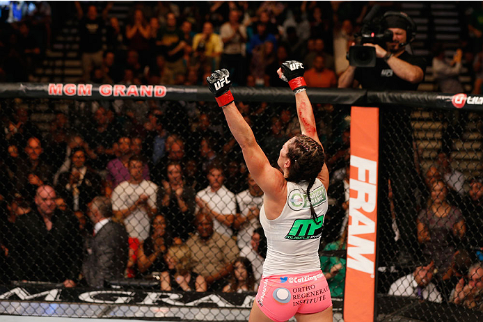 Zingano celebrates her win over Nunes