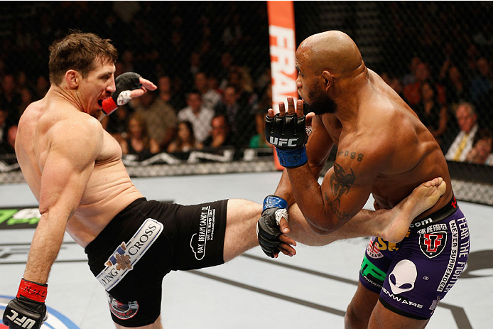 Tim Kennedy kicks <a href='../fighter/Yoel-Romero'>Yoel Romero</a> during their fight at UFC 178.