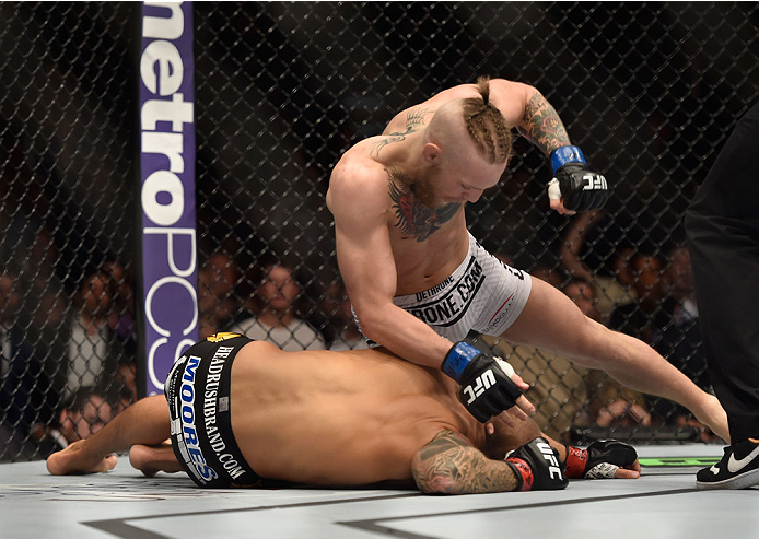 McGregor (top) stops <a href='../fighter/Dustin-Poirier'>Dustin Poirier</a>