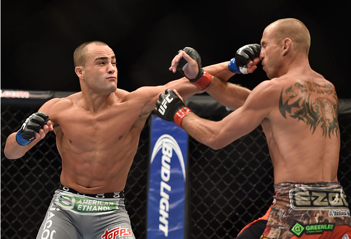 (L-R) Eddie Alvarez punches Donald Cerrone in their lightweight fight during the UFC 178 event inside the MGM Grand Garden Arena on September 27, 2014 in Las Vegas, Nevada. (Photo by Jeff Bottari/Zuffa LLC)