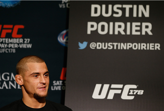 LAS VEGAS, NV - SEPTEMBER 25:  Dustin Poirier interacts with media during the UFC 178 Ultimate Media Day at the MGM Grand Hotel/Casino on September 25, 2014 in Las Vegas, Nevada. (Photo by Josh Hedges/Zuffa LLC/Zuffa LLC via Getty Images)