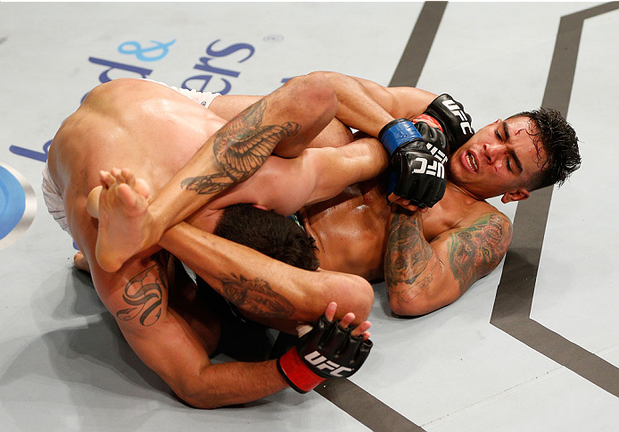 RIO DE JANEIRO, BRAZIL - OCTOBER 25:  (R-L) Andre Fili attempts to secure an arm bar submission against Felipe Arantes of Brazil in their featherweight bout during the UFC 179 event at Maracanazinho on October 25, 2014 in Rio de Janeiro, Brazil.  (Photo by Josh Hedges/Zuffa LLC/Zuffa LLC via Getty Images)