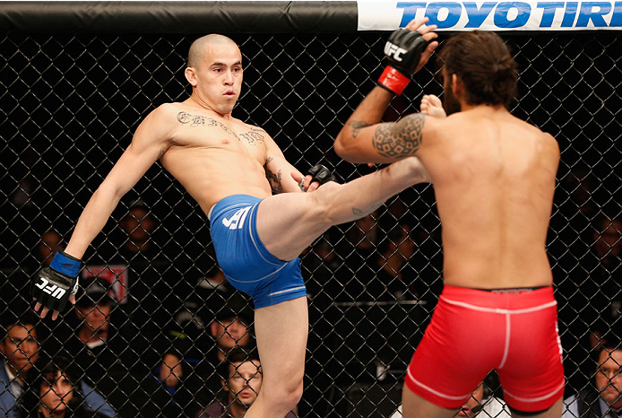 MEXICO CITY, MEXICO - NOVEMBER 15:  (L-R) Marlon Vera kicks Marco Beltra in their bantamweight bout during the UFC 180 event at Arena Ciudad de Mexico on November 15, 2014 in Mexico City, Mexico.  (Photo by Josh Hedges/Zuffa LLC/Zuffa LLC via Getty Images)