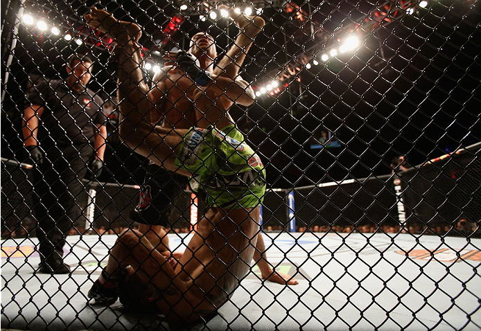 LAS VEGAS, NV - DECEMBER 06:  Tony Ferguson (green shorts) kicks Abel Trujillo in their lightweight bout during the UFC 181 event inside the Mandalay Bay Events Center on December 6, 2014 in Las Vegas, Nevada.  (Photo by Josh Hedges/Zuffa LLC/Zuffa LLC via Getty Images)