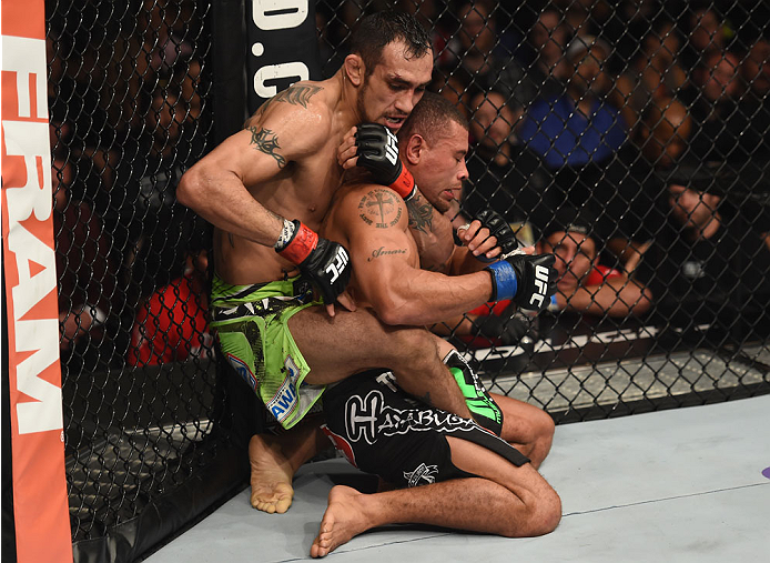 LAS VEGAS, NV - DECEMBER 06:  (L-R) Tony Ferguson attempts to submit Abel Trujillo in their lightweight bout during the UFC 181 event inside the Mandalay Bay Events Center on December 6, 2014 in Las Vegas, Nevada.  (Photo by Robert Laberge/Zuffa LLC/Zuffa LLC via Getty Images)