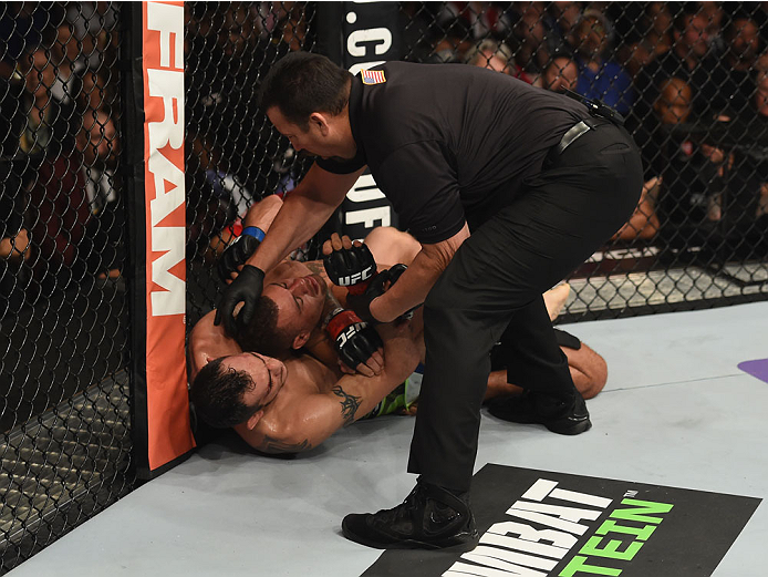 LAS VEGAS, NV - DECEMBER 06:  Tony Ferguson (bottom) attempts to submit Abel Trujillo in their lightweight bout during the UFC 181 event inside the Mandalay Bay Events Center on December 6, 2014 in Las Vegas, Nevada.  (Photo by Robert Laberge/Zuffa LLC/Zuffa LLC via Getty Images)